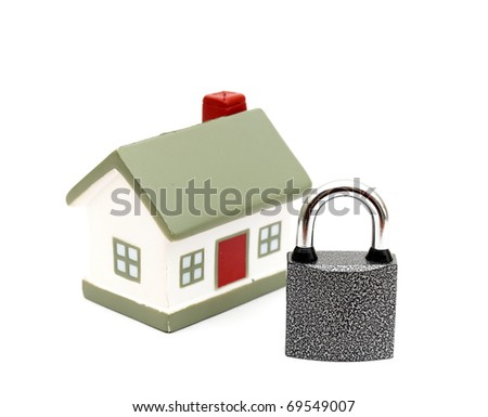 miniature house with lock isolated on white - stock photo