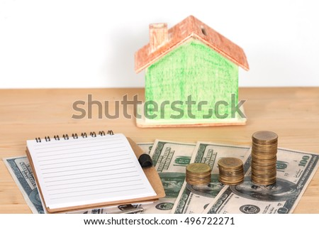 Miniature house with money  to the sale or purchase of Real 