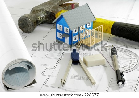 Miniature House With Various Drafting Items and Plans. - stock photo