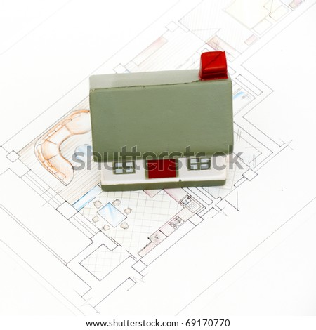 miniature house with various drafting items and plans. (i am author of this drawing) - stock photo