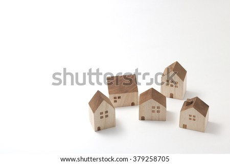 Miniature houses on white background.  - stock photo