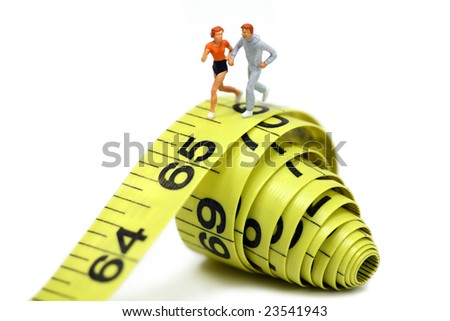 Miniature joggers run on a rolled up yellow measuring tape. Active and healthy lifestyle concept.