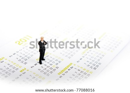 miniature man on kalendar standing - stock photo