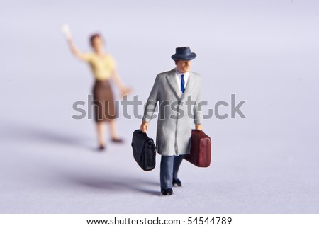 miniature man on travel - stock photo