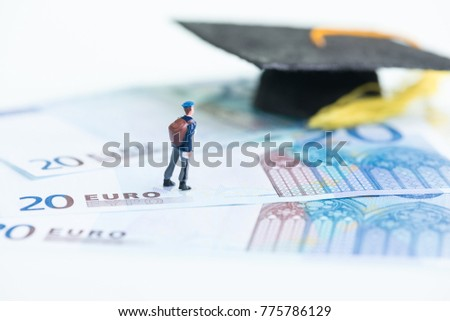 Miniature man standing on top of 20 Euro banknotes