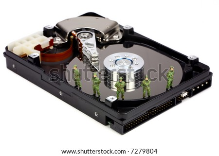 Miniature military soldiers are guarding a computer hard drive from viruses, spyware and identity thieves. Computer data security concept. - stock photo