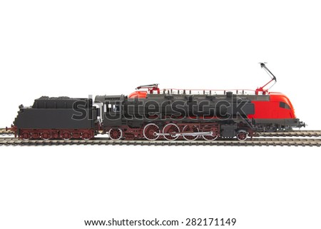 miniature models of trains are isolated on white background - stock photo