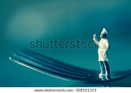 miniature of a cook on a fork - stock photo