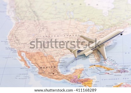 Miniature of a passenger plane taking off the map of United States of America flying to east. Conceptual image for tourism and travel