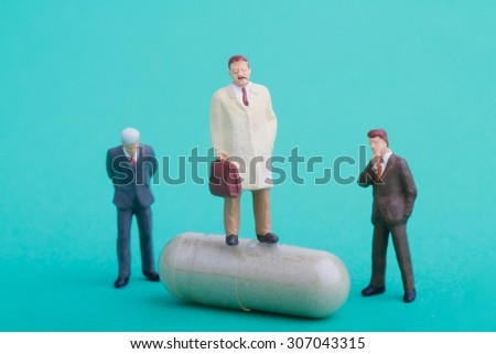 miniature of a pharmaceutical sales representative - stock photo