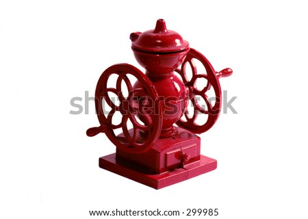 Miniature of an old red metal coffee grinder. - stock photo