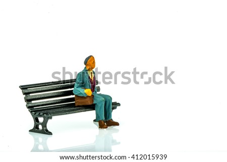 Miniature people business traveler concept sit on chair on white background with a space for text - stock photo
