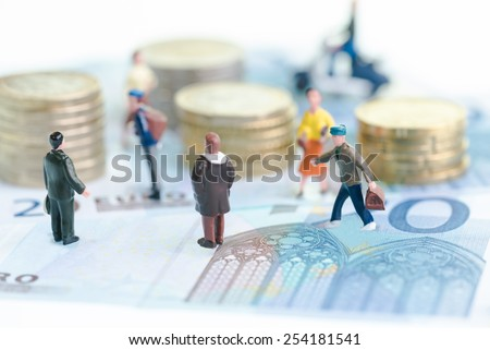 Miniature people on Euro banknotes close up