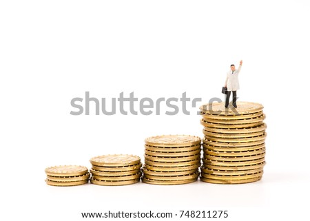 miniature people on stack gold coin,business concept