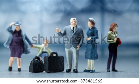 Miniature people - people waiting in the airport lobby - stock photo