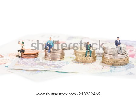 Miniature people sitting on savings or retirement funds  - stock photo