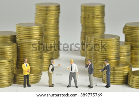 miniature people team agreement with stack of coins and calendar background