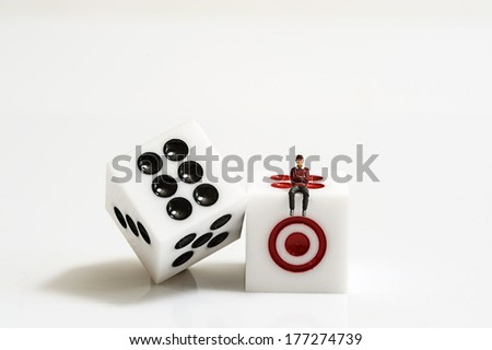 Miniature people with dice - stock photo
