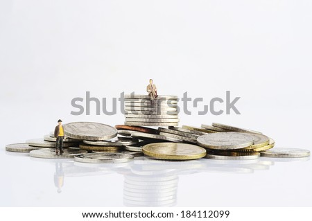 Miniature peoples with finance - stock photo