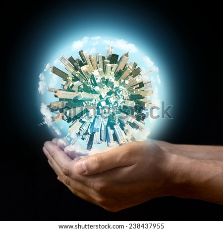 Miniature planet in the hands - stock photo
