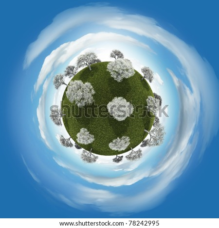 Miniature planet of blossoming trees vegetation and atmosphere with clouds - stock photo