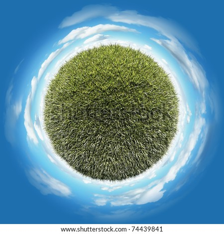 Miniature planet with clear long grass lawn vegetation and clouds on blue sky - stock photo