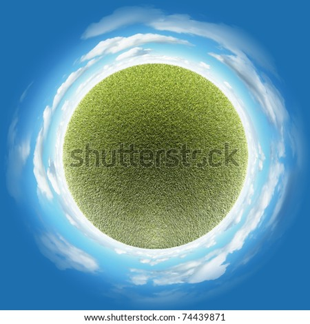 Miniature planet with clear thick grass lawn vegetation and clouds on blue sky - stock photo