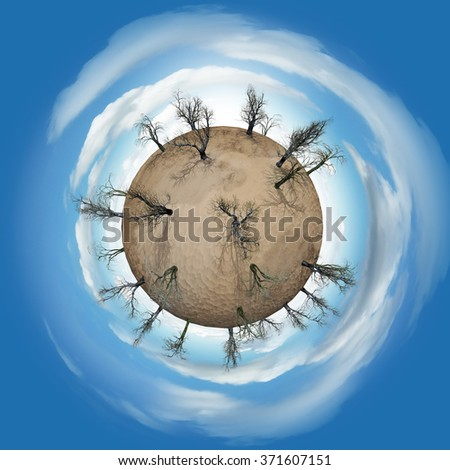 Miniature planet with leafless bald trees in desert and atmosphere with clouds - stock photo