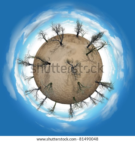 Miniature planet with leafless trees in desert and atmosphere with clouds - stock photo