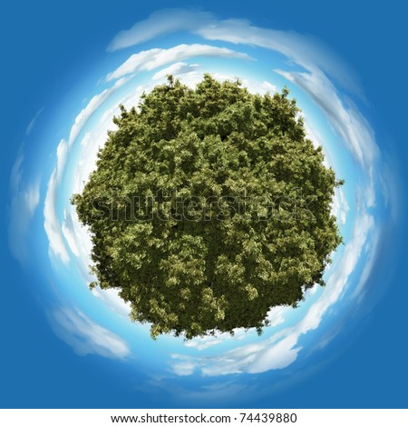 Miniature planet with leafy forest vegetation and clouds on blue sky - stock photo