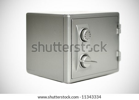 Miniature safe on white with slight vignette - stock photo