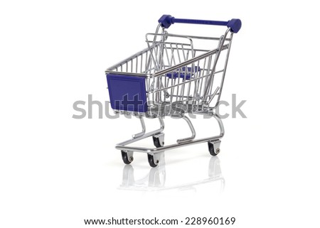 Miniature shopping cart isolated on white background
