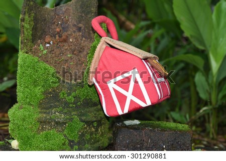 miniature small red color house on green grass environment friendly - stock photo