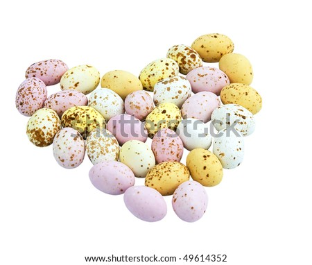 Miniature speckled chocolate Easter eggs in the shape of a heart - stock photo