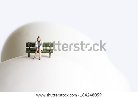 Miniature thinking woman - stock photo