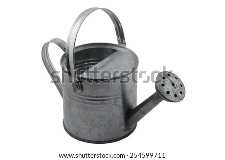 miniature tin watering can on a white background - stock photo