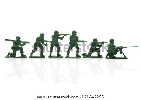 miniature toy soldiers with guns on white background - stock photo