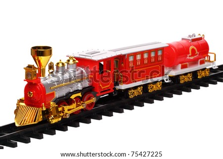 Miniature train on track isolated on a white background