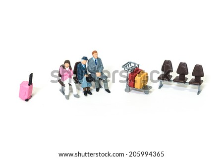 Miniature traveler figures with luggages waiting for departure at Airport  - stock photo