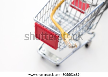 Miniature trolley with LAN cable. Conception of shopping on the internet - stock photo