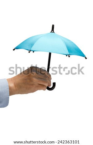 Miniature umbrella held by a hand, isolated on white - stock photo