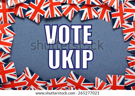 Miniature Union Jack flags form a border on blue card around the phrase Vote UKIP or UK Independence Party for the UK General Election - stock photo