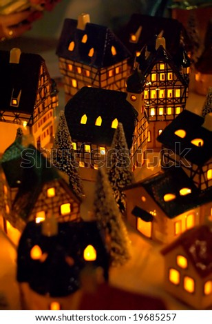 Miniature village made of traditional christmas candle houses - stock photo