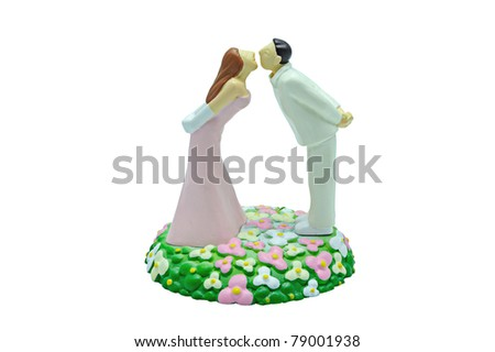 Miniature wedding couple doll isolated on white - stock photo