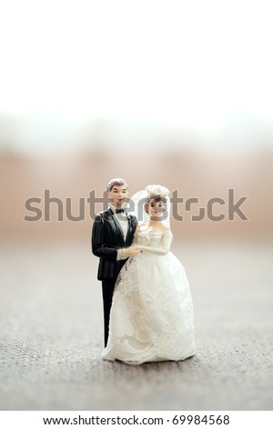 miniature wedding couple doll with blur background - stock photo