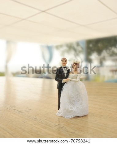 miniature wedding doll in outdoor banquet - stock photo