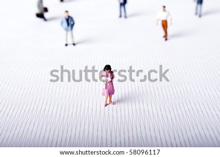 miniature woman alone - stock photo