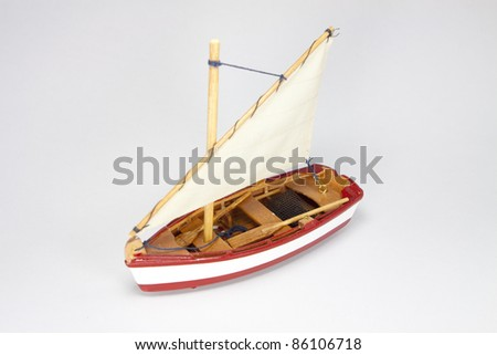 Miniature wooden model of a fishing boat isolated. - stock photo