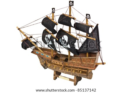 Miniature wooden model of a pirates ship isolated on white background