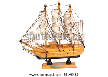 Miniature wooden model of a ship isolated on white background - stock photo